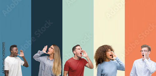 Leinwanddruck Bild Group of people over vintage colors background shouting and screaming loud to side with hand on mouth. Communication concept.
