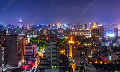 night metropolis cityscape with lighting up and skyline - 211631159