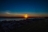 Sunset over Lake with a Rock Shoreline