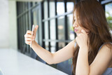 Asian woman using smart phone in restaurant - 211637968
