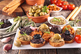 bread toast with tapenade - 211647945