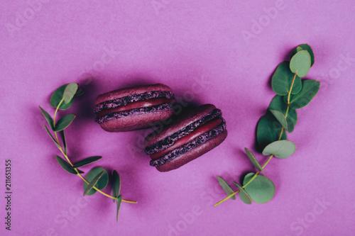 Fotobehang Macarons Two purple macarons on violet background