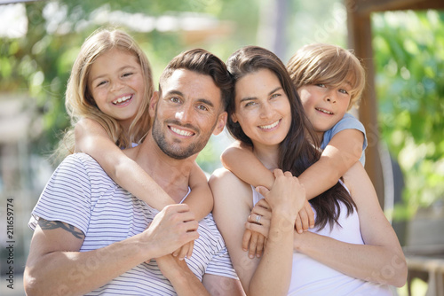 Portrait of happy family on summer day - 211659774