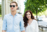 Couple walking together in a city - 211667529