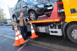 Leinwanddruck Bild - a tow truck takes away a broken car