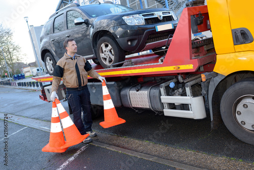Fototapeta a tow truck takes away a broken car