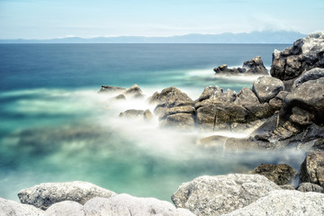Beautiful summer scene where sea waves are breaking up from the rocks, Sithonia Greece © wabeno