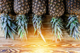 Ripe pineapples on a wooden background. Top view