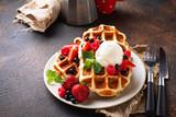 Belgium waffles with berries and ice cream