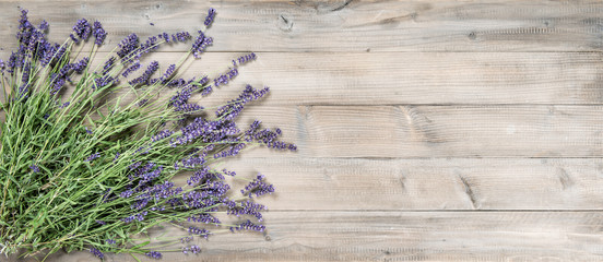 Lavender flowers rustic wooden background Vintage still life © LiliGraphie