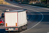 Road transport. Lorry in motion on the motorway - 211699530