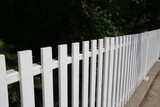 White picket fence in park - 211699942