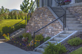 Dual stairs to the entry of a cottage style home