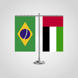 Table stand with flags of Brazil and United Arab Emirates.Two flag. Flag pole. Symbolizing the cooperation between the two countries. Table flags