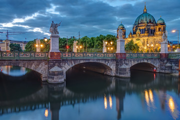 The Schlossbruecke and the cathedral in Berlin at dusk © elxeneize