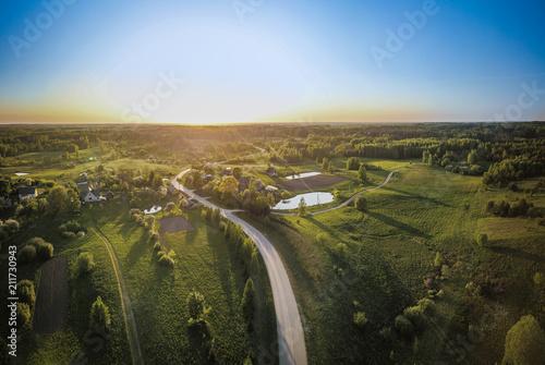 Fototapeta Sunset in countryside land