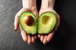 Leinwanddruck Bild - Fresh avocado fruit in girl hands. The concept of healthy eating. Food photography