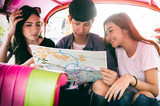Group of tourist sitting in tuk-tuk taxi