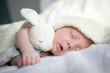 Leinwanddruck Bild - Newborn baby boy portrait on white carpet closeup. Motherhood and new life concept
