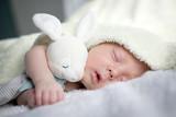 Newborn baby boy portrait on white carpet closeup. Motherhood and new life concept - 211751750