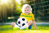 Brazil football fan kids. Children play soccer. - 211758973