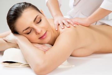 Beautiful woman on a body massage