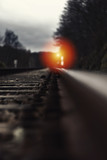 Railroad track with signal lamp in the distance - 211761109