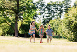 Three happy kids holding hands and running - 211770161