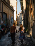 Couple walking the street in Rome, Italy. October 2017.