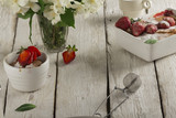 Cottage cheese casserole in white dish decorated with strawberries - 211783341