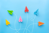 Paper plane on blue background. Different vision creative and Innovative solution for Business concepts.