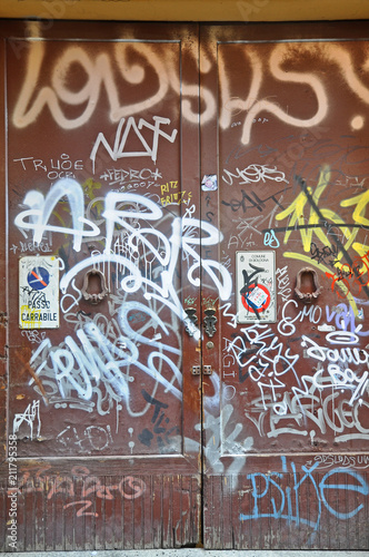 Italy, Bologna downtown artistic decorated door - 211795358