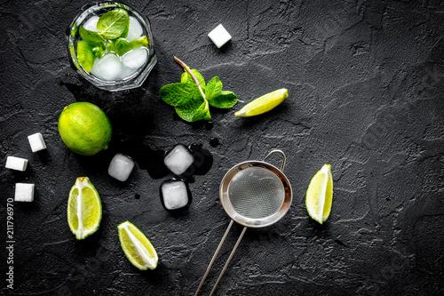Leinwanddruck Bild making mojito on dark background top view