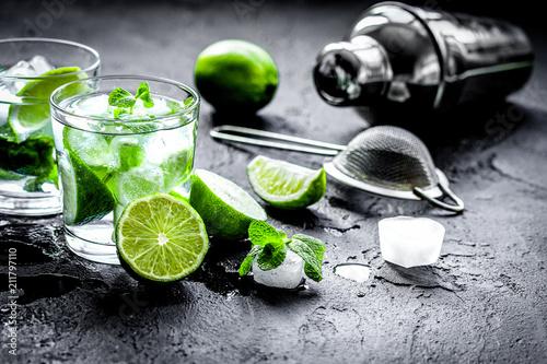 Leinwanddruck Bild mojito in glass on dark background close up