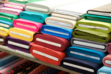 colorful fabric rolls on textile market -