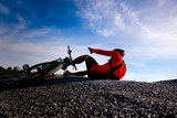Cyclist riding mountain bike on the rocky trail at sunset,crashing on mountain bike.