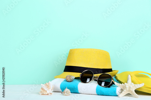 Summer accessories with seashells on mint background - 211828140