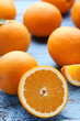 Orange fruit on blue wooden table