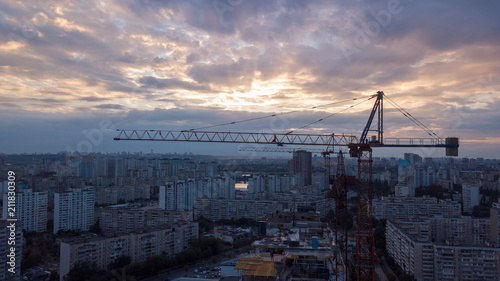 Fotobehang Thailand Building cranes building new building construction on the sunset background