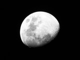 Half Moon, Crescent moon, gibbous moon in the middle of its way on the clear sky. - 211849534