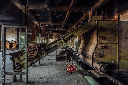Fotobehang Oude verlaten gebouwen Abandoned tea factory with remnant of rusty equipment