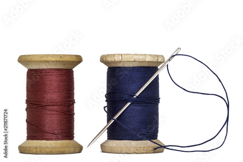 sewing threads spools with sewing needle,isolated on white background