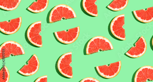Halved fresh grapefruits on bright color background - 211871755
