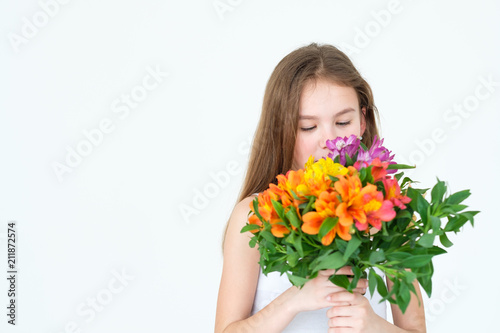 special flower bouquet delivery for someone you love. little girl holding a festive colorful floral arrangement of alstroemeria - 211872574
