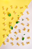 Farfalle Pasta on pink and yellow - 211885324