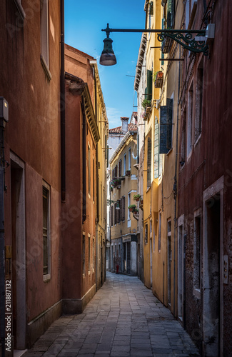 View of the colorful Venetian houses on street. Venice, Italy. - 211887132