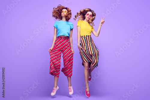 Fototapeta Two Girls Having Fun Dance. Fashion Summer Outfit