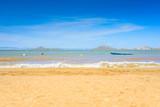 European sandy beach, boat and blue sea. - 211894780