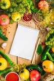 Recipe Notebook Food Rama Yellow Tomatoes Cucumbers Pepper and Spices on Wooden Background - 211894901