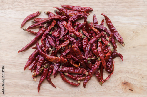 Fotobehang Hot chili peppers close up of dry chili on wooden background